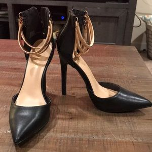Black heels with gold straps